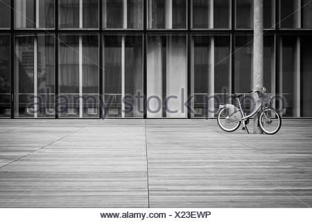 Bicycle Parked Against Pillar - Stock Photo