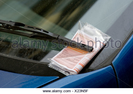 Parking ticket under the windscreen wiper of a parked car, Munich, Bavaria, Germany, Europe - Stock Photo