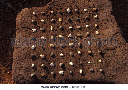 Hawaiian game konane, played similar to checkers, Lapakahi, Big island of Hawaii - Stock Photo