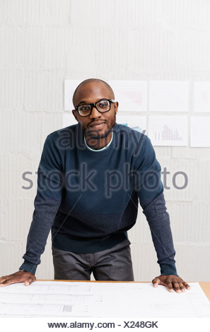 Portrait of young businessman in design office - Stock Photo