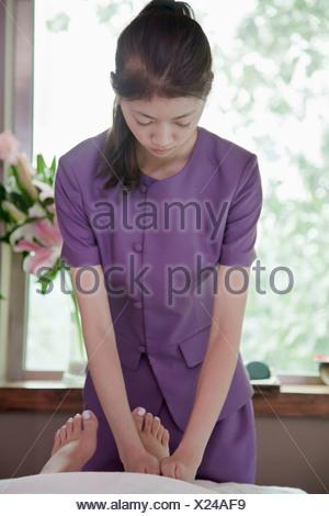 Woman Receiving Foot Massage - Stock Photo