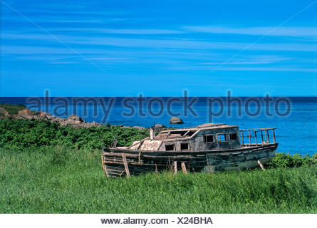 Old wooden fishing boat on shore of Gulf of St. Lawrence, Ste Felicite, Quebec, Canada - Stock Photo