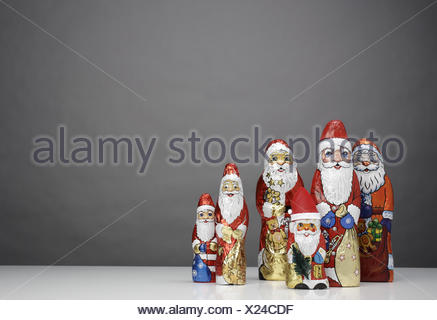 Chocolate Santa Clauses, differently, - Stock Photo