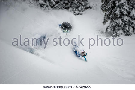 Young man Deep powder skiing in Austria - Stock Photo