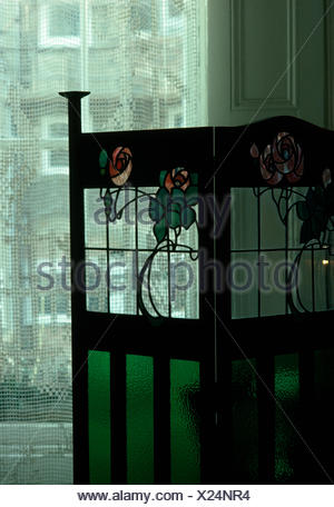 Close-up of Art Nouveau stained glass screen - Stock Photo