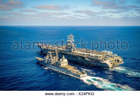 PACIFIC OCEAN (Oct. 25, 2014) The aircraft carrier USS Nimitz (CVN 68) and the Ticonderoga-class guided-missile cruiser USS Lake Champlain (CG 57) - Stock Photo