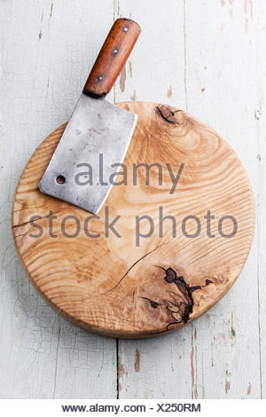 Meat cleaver on blue wooden background - Stock Photo
