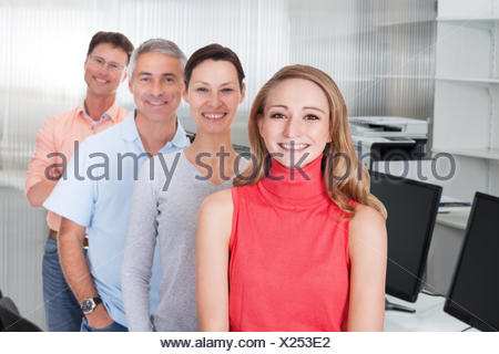 Four business associates in casual clothes - Stock Photo