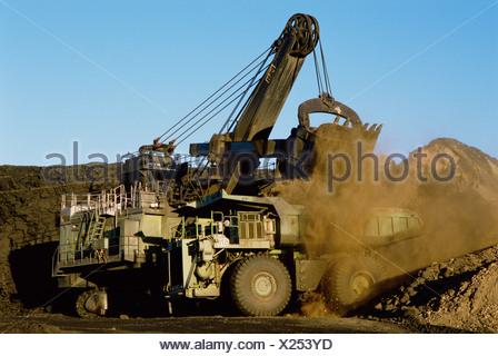 Australia. Open cut coal mining. Loading truck. - Stock Photo
