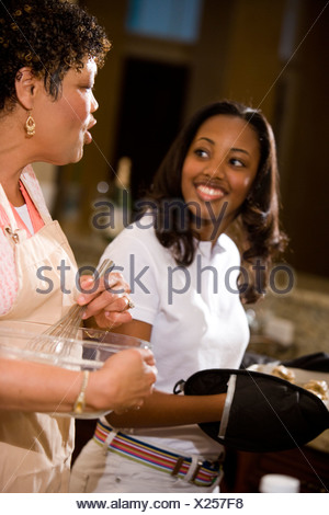 Grandmother and teenage girl baking cookies - Stock Photo