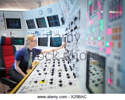Female operator in nuclear power station control room simulator - Stock Photo