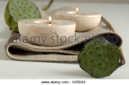 candle holders and lotus flowers - Stock Photo