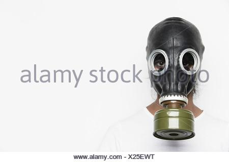 Woman wearing gas mask - Stock Photo