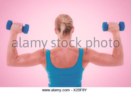 Composite image of rear view of muscular woman lifting dumbbells - Stock Photo