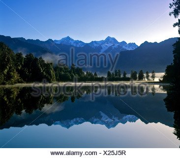 Matheson Lake with Aoraki or Mount Cook reflected on surface, Southern Alps, South Island, New Zealand - Stock Photo