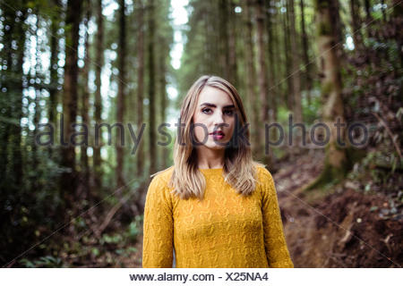 Pretty blonde woman smiling at camera - Stock Photo