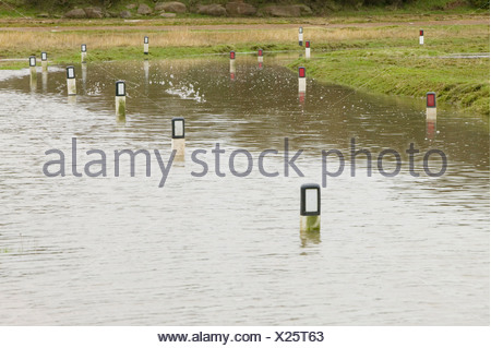 A road near Sunderland Point Morecambe Bay UK flooded by a combination of high tide and storm force winds - Stock Photo