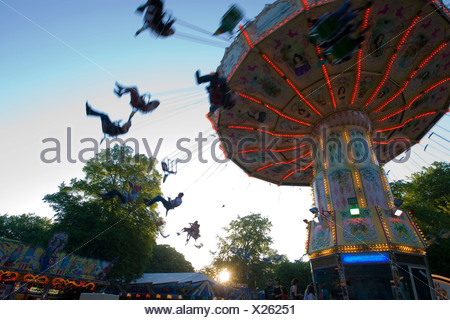 Chair-O-Planes or swing carousel amusement ride at the traditional Waeldchestag celebration, Frankfurt, Hesse, Germany, Europe - Stock Photo