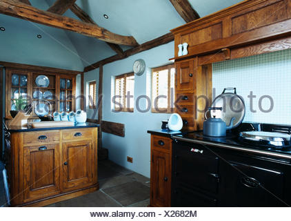blue country kitchens. Blue Kettle On Black Aga In Pastel Country Kitchen With Stained Wood Units - Stock Kitchens