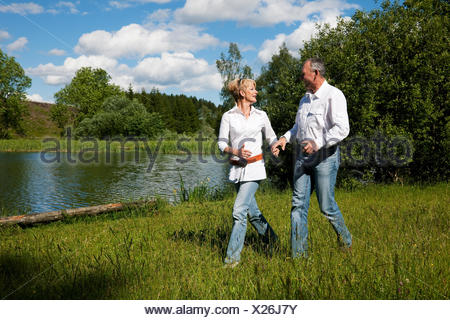 elderly couple on a lake - Stock Photo