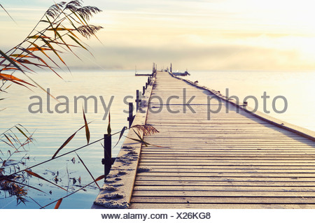View over waterscape and jetty - Stock Photo