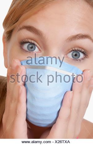 Woman wearing a flu mask - Stock Photo