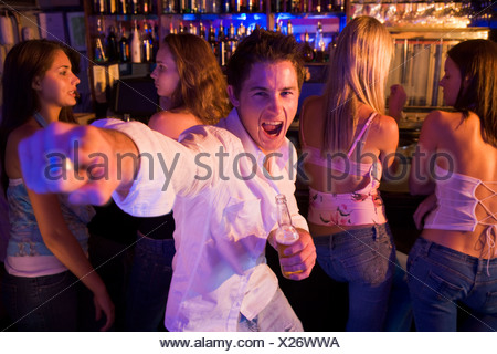 Young man in a bar - Stock Photo
