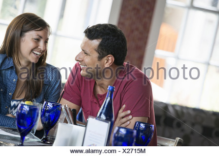 A cafe interior. A couple seated at a table. - Stock Photo