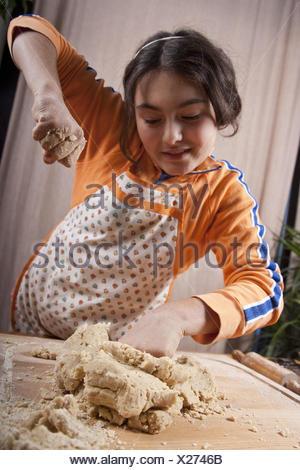 Girls, dough, knead, people, child, smile, bake proudly, cake, bread, freshly, joy, hands, apron, cooking apron, - Stock Photo