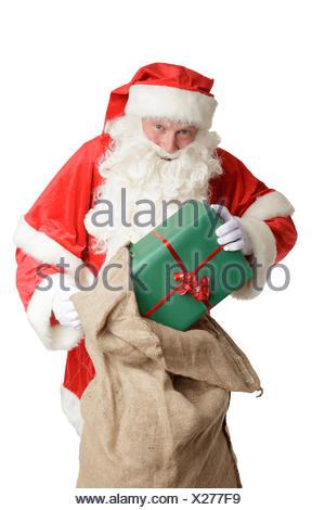 Santa Claus is bringing presents - Stock Photo