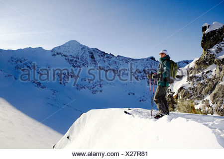 Man looking at the view in the Whistler backcountry, Coast Mountains, British Columbia, Canada. - Stock Photo