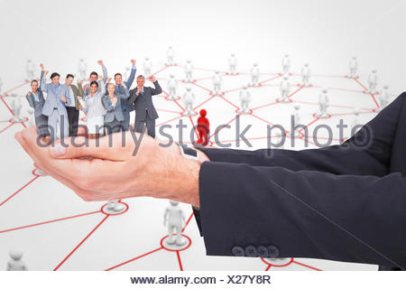 Composite image of excited business team cheering at camera - Stock Photo
