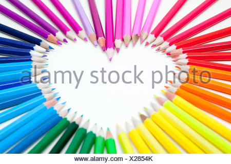 Pencils arranged in a heart shape - Stock Photo