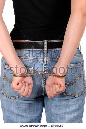 In Handschellen / In handcuffs - Stock Photo