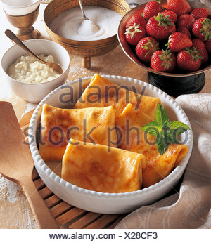 Pancake parcels will with fresh strawberries and cream cheese, Israel, recipe available for a fee - Stock Photo