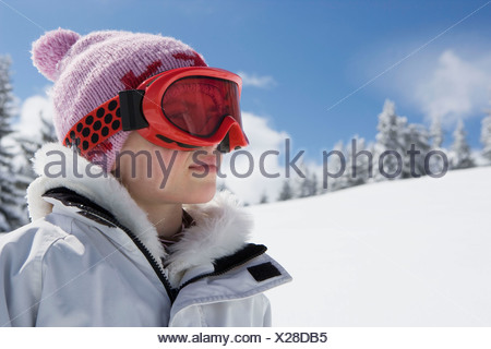 Portrait of girl with hat and goggles - Stock Photo