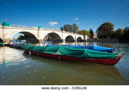 Boats moored on the River Thames by Richmond Bridge, Surrey, Uk - Stock Photo
