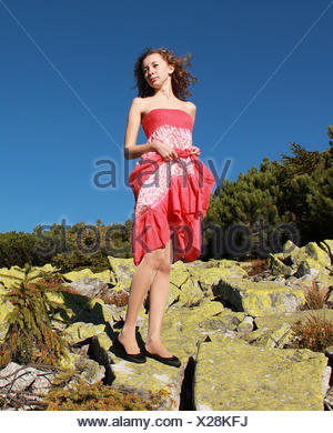 Tatra Mountains, Young woman on top of mountain - Stock Photo