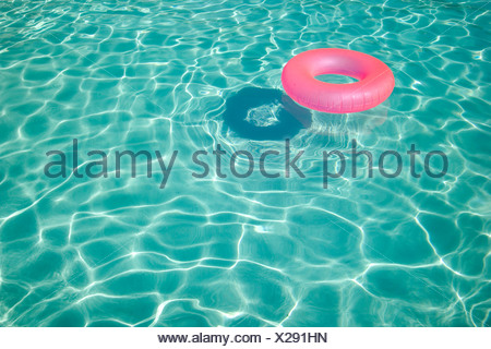 Floatation device in a swimming pool - Stock Photo