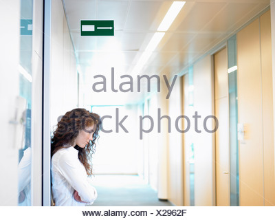 Business woman against the wall - Stock Photo