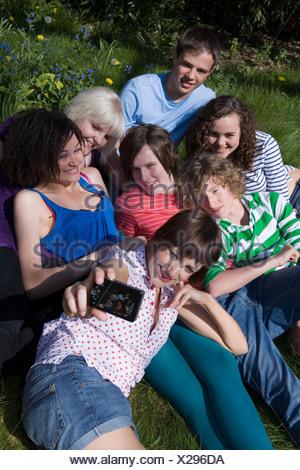 Friends having photo taken - Stock Photo