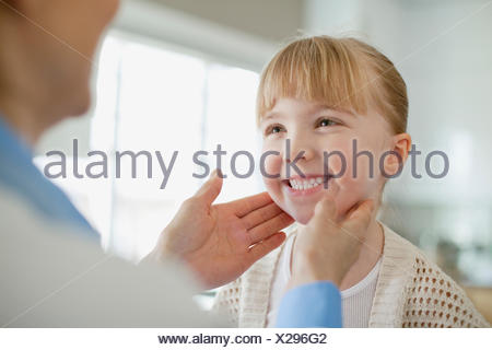 doctor examining young girl - Stock Photo