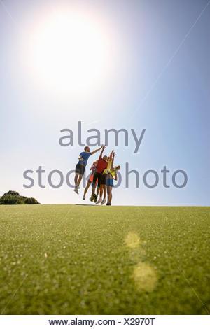 Small group of people wearing sportswear, celebrating - Stock Photo
