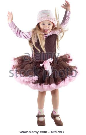 Little girl in studio jumping - Stock Photo