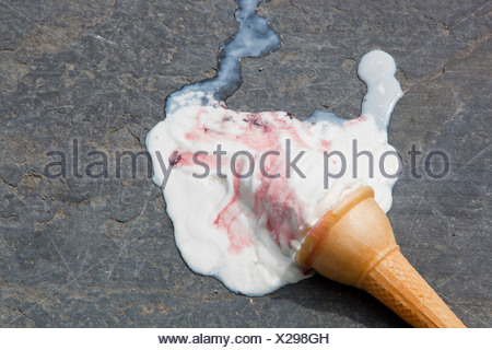 An ice cream melting on the shores of Lake Windermere Cumbria UK during a summer heat wave - Stock Photo