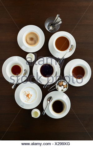 Still life with selection of coffees in cups - Stock Photo