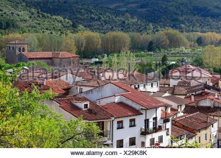 panoramic view of of Covarrubias, red roofs of houses in front, on right bell towers of Collegiate church of Saints Cosmas and Damian (1474), Ruta - Stock Photo
