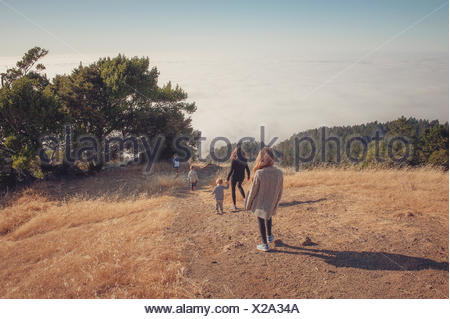 Mother hiking with four children, Tamalpais Valley, California, United States - Stock Photo