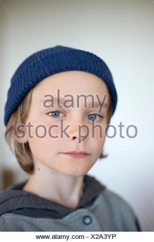 Sweden, Vastergotland, Lerum, Portrait of boy (10-11) wearing blue knit hat - Stock Photo