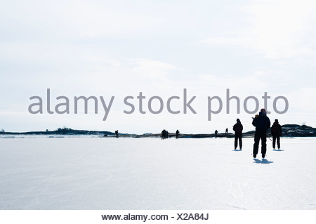 Ice skaters out on the ice - Stock Photo